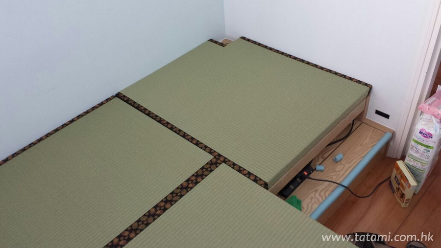Thanks for the photographs from our customer! The wood platform is an original design in this apartment, our customer chose Japanese Moisture-proof tatami for the new designs, so the transformations we have made:<br /> 1. Special size requirement. The new diferent tatami sizes are based on the original size of the wood platform, transformed into more flexible and easily storage space.<br /><br>2. The remaining tatami materials are also covering the cabinet, the total out-look of the room should be clearer to the eyes, the tatami material resources are used efficiency at the same time.<br />atami set up is avoided of the electric sockets.<br />Auguest, 2014